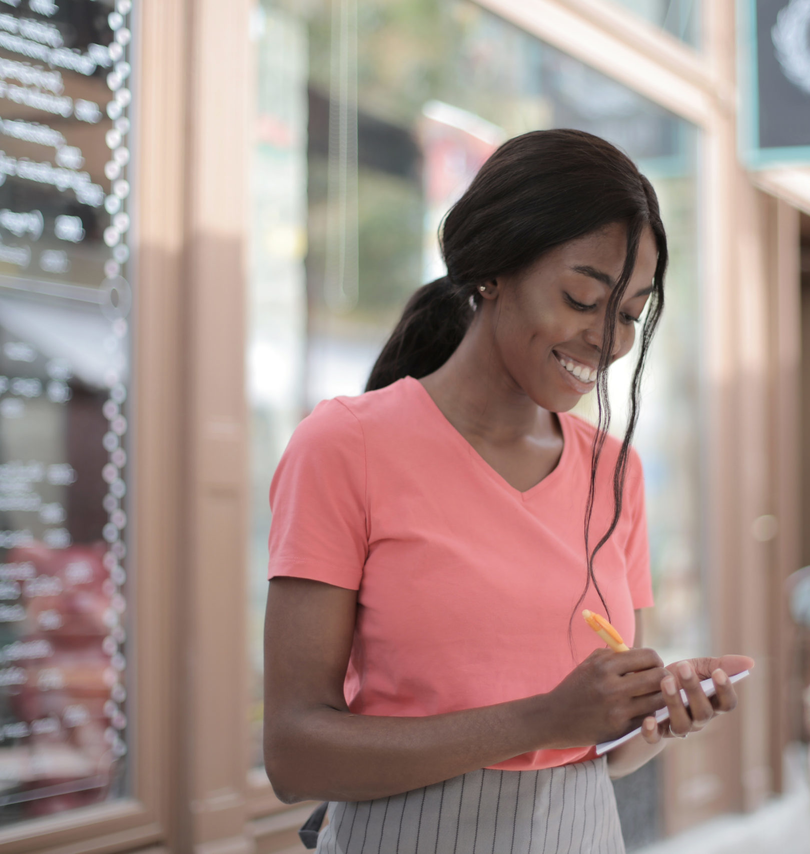 Canva – Photo of Woman Taking Order From a Customer